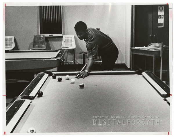Wake Forest Student Playing Pool in Dormitory