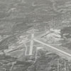 Aerial view showing the construction of Z. Smith Reynolds Airport Terminal Building, 1942.