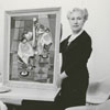 Mrs. Ruth Julian with a painting at the James G. Hanes Community Center, 1958.