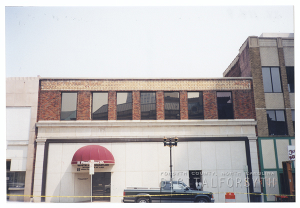 Buildings near the corner of West Fourth and North Liberty Streets, to be demolished for the One West Fourth building, 2000.