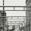 Larry Haga, traveling by buildings (at left) soon to be razed for the new Wachovia Bank Building, 1962.