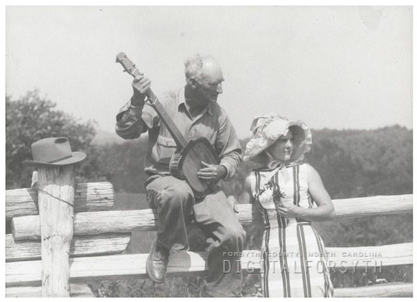 Odell Key plays a song on the banjo for Mrs. James Baldwin, 1960.