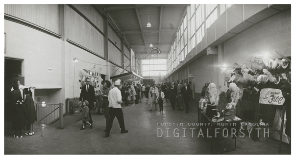 Entering the Memorial Coliseum for a political campaign rally featuring Henry Cabot Lodge, 1960.