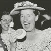 Minnie Pearl (with the hat) and Joe Cox (at right), 1960.