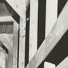 J. D. McDaniel walking through a wooden walkway in a construction area, 1959.
