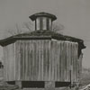 Slave quarters (left) and a barn at Cooleemee Plantation, 1949.