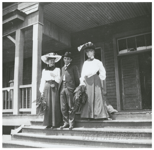 Blanche Thomas Sumner Hege (left) with two unidentified people.