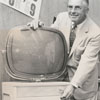 Frank W. Butterfield with a new Philco television, 1958.