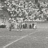 Frank Jones, right, photographing the Wake Forest College vs Maryland football game, 1958.
