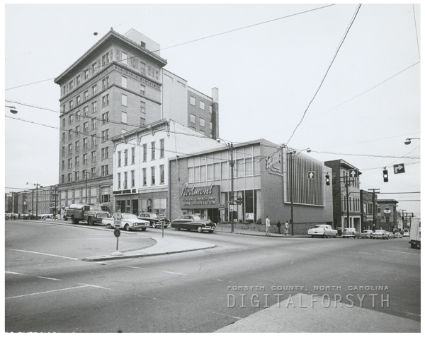 Group of businesses in the block of West Third Street at Liberty Street, across from the Forsyth County Courthouse, 1961.