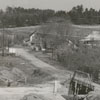 Bridge under construction at Muddy Creek to take the kink out of an old road connecting Highway 67 with Bethania, 1962.