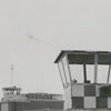 William O'Neal and Mrs. Kem Naftel, pilots, look at the mobile tower at Smith Reynolds Airport, 1957.