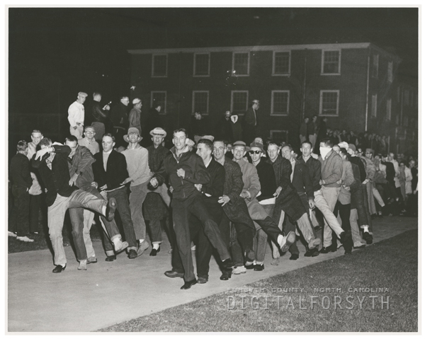 Wake Forest College students dancing 'Bunny Hop' to protest the campus ban on dancing, 1957.