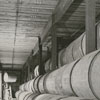 Hogsheads, packed with leaf tobacco, in R. J. Reynolds Tobacco Company's storage warehouse, 1956.