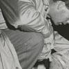 Men working on the injured player, Ray Ingram of Hanes High School, 1956.