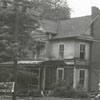 Demolition of the Pleasant Henderson Hanes house at 419 N. Cherry Street, 1948.