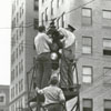 Cleaning the traffic signal lights in preparation for Easter, 1939.