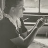Mary McKnight making wood carvings, 1940.