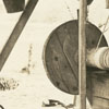 Country well showing an old windlass and bucket, 1938.