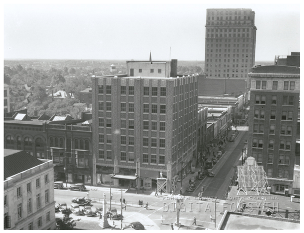 View looking west on West Fourth Street at North Liberty Street, 1939.