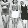 Sunbathers modeling swimsuits from a variety of time periods, 1942.