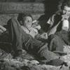 Tobacco farmers keeping a vigil near the tobacco curing barns, 1942.