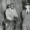 Men (left and right) shoveling coal, 1950.