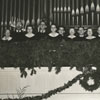 Choir members in the choir loft of an unidentified church.
