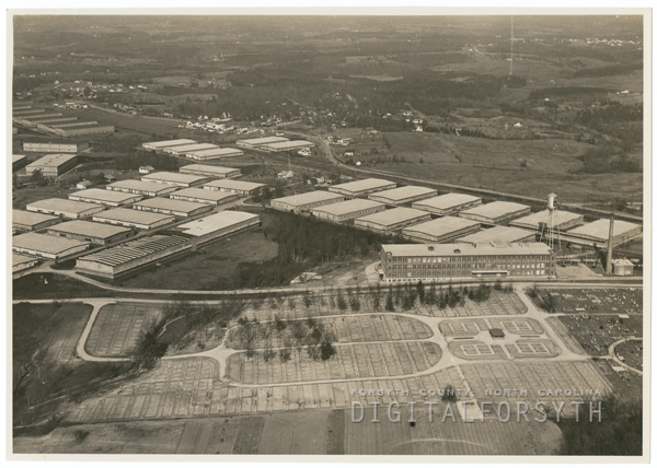 Aerial showing R. J. Reynolds Tobacco Company tobacco sheds, 1938.