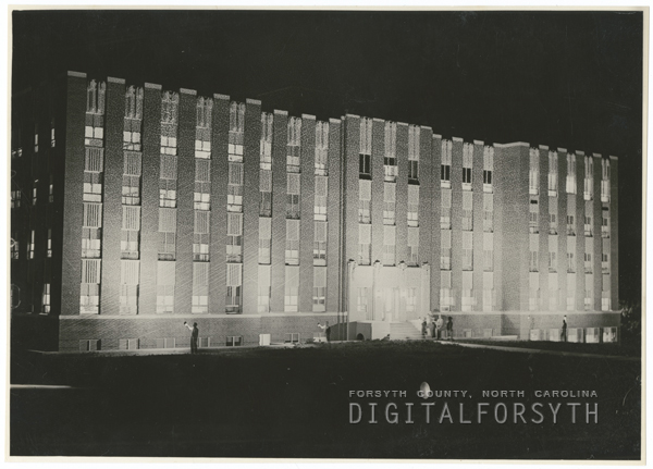 Night photo of Kate Bitting Reynolds Hospital, 1938.