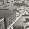 View from above North Church Street in the 200 block, with tobacco factories at the left.
