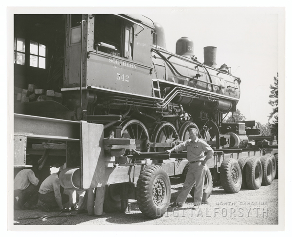 Train locomotive being moved to Tanglewood Park in Clemmons, N. C., 1954.