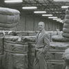 Ralph Hanes and bales in warehouse, 1966.
