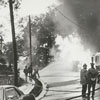 Firemen at a gasoline tank truck fire on East Fifth Street, 1969.