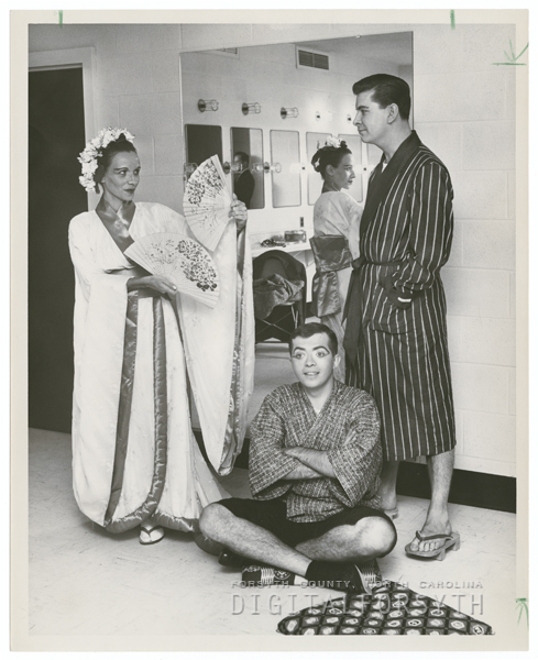 Actors advertising a Little Theatre play, 1958.