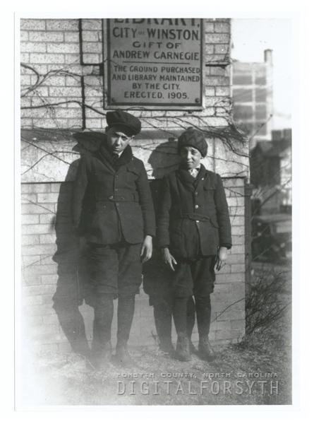 Boys standing near corner of Carnegie Library.
