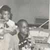 Children with toys at East Winston Branch Library, 1964.