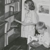 Children looking at books in the Carnegie Library.