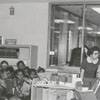 Author Arna Bontemps reads to children at the East Winston Branch Library, 1956.