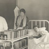 Carnegie Librarian, Janet Berkeley, taking books to patients in the City Hospital.
