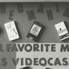 Bulletin board advertising videocassettes at the library.