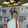 "Librarian Art Weeks in front of the ""Pops"" collection at Thruway Branch Library, 1988."