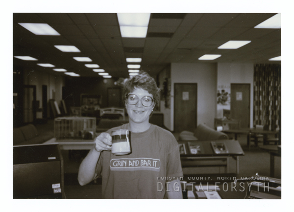 Librarian Cal Shepard works on the barcoding project for the library, 1989.