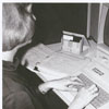 Librarian Joy White conducting an on-line information retrieval search in the Business Science Department, 1985.