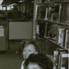 Barcoding books as part of the library's automation project, 1989.