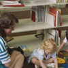 Mother and children in the library's children's room.