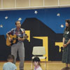 Reading program in the library's auditorium with librarians Jon Sundell and Merrikay Brown.