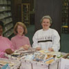 Thruway Branch Library interior, showing librarians and carts filled with returned books.