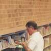 Selecting books in the new Reynolda Manor Branch Library, 1998.