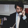 Librarian Jerry Carroll at the Business Science Department desk, 1984.